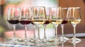 Several stemware glasses filled with wine