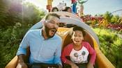 Family rides Slinky Dog ride
