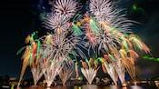 Fireworks bursting over World Showcase Lagoon at Epcot