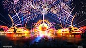 Fireworks light up the sky over characters from the Disney film Coco