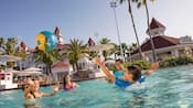 A family of 4 playing in a pool at Disney's Grand Floridian Resort & Spa