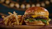 A cheeseburger on a brioche bun and french fries