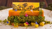 A dessert featuring an image of the Lion King on a layer of caramelized orange, chocolate pastry and decorative