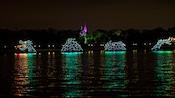 An electric light sea monster sailing over Seven Seas Lagoon