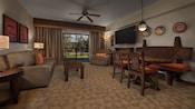 Une chambre avec une terrasse, un canapé, 3lampes, une peinture murale, une chaise rembourrée, un téléviseur et une table à manger avec des chaises