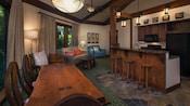 O interior de uma Villa, com um mix de móveis de madeira e estofados e uma cozinha