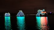 A sea monster made of lights on a lake