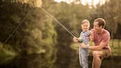 A man teaches his daughter how to fish