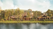 Pinos rodeando 3 cabañas frente al lago en Cooper Creek Villas & Cabins en Disney's Wilderness Lodge