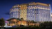 Exterior da Gran Destino Tower, no Disney's Coronado Springs Resort, iluminada à noite