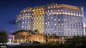 The exterior of Gran Destino Tower at Disneys Coronado Springs Resort, illuminated at night