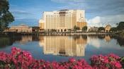 The multistory Disney's Coronado Springs Resort hotel situated on the shores of Lago Dorago