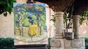 Um poço e uma pintura da Snow White sentada em um poço