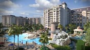 An enormous Resort swimming pool with a water slide that winds down from a tower