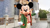 Mickey Mouse, dressed in his holiday finery, greets you on the bridge of Cinderella Castle