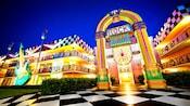 The illuminated exterior of Disney's All Star Music Resort