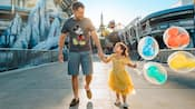 A little girl and her dad holding hands while walking through Tomorrowland at Magic Kingdom park