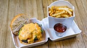 Burger with grilled asparagus celery salad, spiced hollandaise, Swiss cheese and artichoke aioli, served with crinkle cut French fries and ketchup.