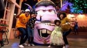 A mom, dad and their 2 kids strike a frightful pose with Vampire Mater in Cars Land
