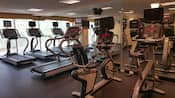 A fitness room with treadmills and other exercise machines
