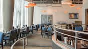 A large, modern restaurant dining room with an open ceiling design