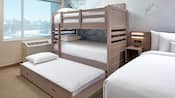 The Deluxe Kids Suite with a bunk bed, a pull out bed and a full bed