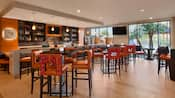 A wine bar and its dining space have modern décor and furniture