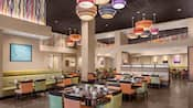 With modern lighting fixtures and decor, tables and chairs in the California Grill dining room await guests
