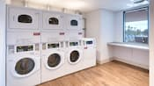 A public laundry room with modern washers and dryers