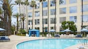 A swimming pool at the Hyatt Regency Orange County hotel, with lounge chairs and cabanas