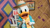 Donald Duck dressed in a Hawaiian shirt
