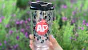 A tumbler for drinking, styled with a pattern of Mickey Ears and an Annual Passholder logo