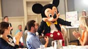 Mickey Mouse greets Guests at a conference in a ballroom