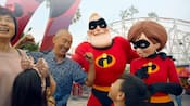 A family of four meets Mr Incredible and Elastigirl at Pixar Pier