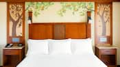 King size bed and 2 nightstands against a wall featuring a citrus tree motif