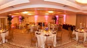 Fisheye view of banquet room with round tables set formally
