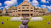 Chairs and flowers set up on the Croquet Lawn behind the main building