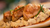 Juicy pieces of grilled pork tenderloin on a bed of seasoned risotto