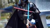 A little boy battles Darth Vader at the Jedi Training Academy