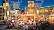 Guests enjoy festive outdoor dining at Uva Bar and Café in the Downtown Disney District