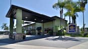 The carport overhang and entrance to Best Western Plus Pavilions accented with palm trees