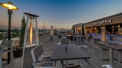 The rooftop bar has tables and chairs, space heaters and a fire pit