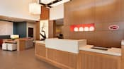 The illuminated front lobby at Hyatt Place at Anaheim Resort/Convention Center with modern décor and lounge areas