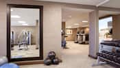 Dumbbells, treadmills and exercise machines fill the health club at the Hyatt Regency Orange County