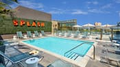 The rooftop pool area has a wide deck with plenty of lounge chairs