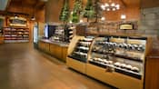 A self serve snack shop with prepared sandwiches, cookies, muffins, bagels, salads, drinks and more