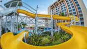 Water rushes down the curved flume of the California Streamin water slide and into the pool