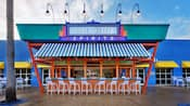 Blue-and-white-striped awning and bar chairs at Silver Screen Spirits Pool Bar
