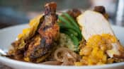 Bowl of grilled chicken with rice and vegetables