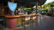 The open-air Uzima Springs Pool Bar with chair-stools